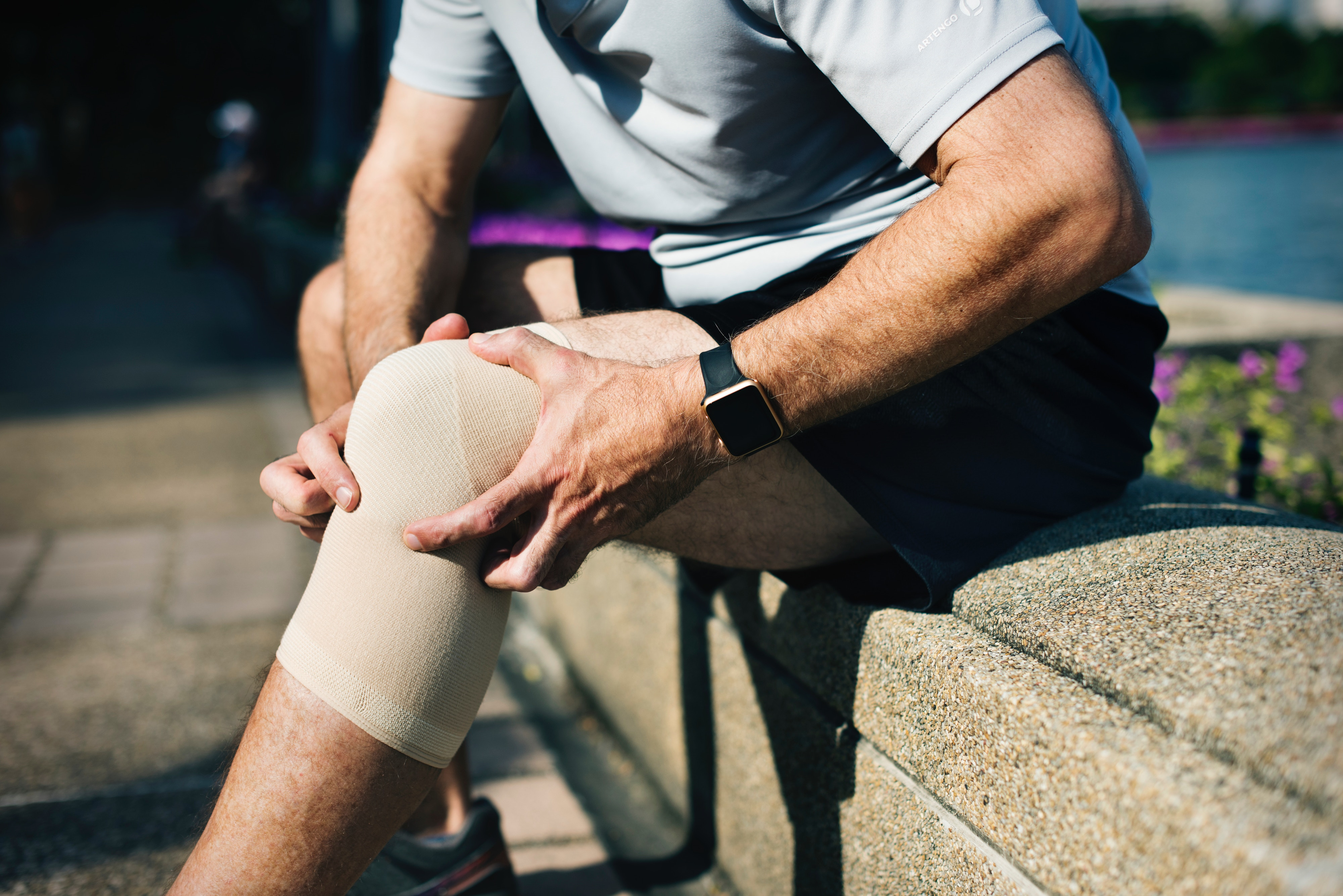 Man holds his bandaged knee